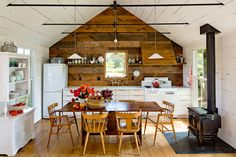 amazing 540 sq ft home for a family of 4. Features a green roof, woodstove, and white oak floors. (more info http://www.jhinteriordesign.com/tiny-house/)