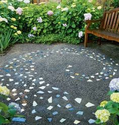 great idea using smaller tiles to bring color to the mosaic .  Milky Way in tile garden path