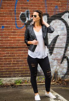 Casual weekend outfit ideas with a cropped leather jacket, white tee, distressed black jeans and sneakers.