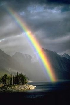 "Rainbow in the Canadian Rockies. ""Rainbows apologize for angry skies"" (Sylvia Voirols)"