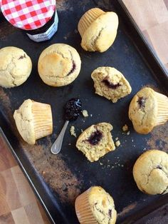 These light and fluffy whole grain muffins are packed with nutrients and filled with sweet and tangy blackberry preserves. #muffins #breakfast #baking #snacks