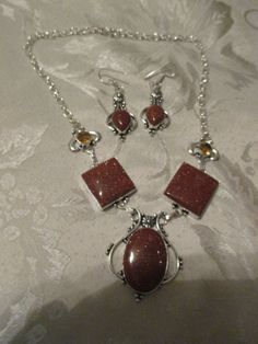 New with out tags a brand new unused unworn item handmade Sunstone antique style 925 overlay necklace and earring set necklace is 17 inches long and earrings are 2 inches