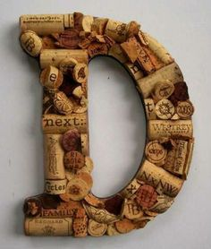 The Letter D out of recycled cork screws - Pinned from @Glossi, a free digital magazine creation platform