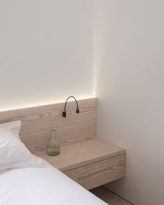 Bedroom Ideas - This simply finished modern bedroom features flush faced built-in hanging cupboards, bespoke Douglas fir bedside cabinetry, and hidden lighting that creates a calm atmosphere. Hidden Lighting, Cove Lighting, Wood Slat Wall, Wood Slats, Timber Walls, Wooden Walls, Latte, Flush Doors, London Apartment