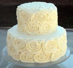 White Wedding Cake Featuring Piped Roses