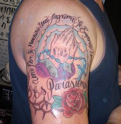 Praying hands woth rosary tattoo