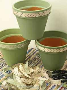 Painted Terracotta Pots with Jane Means Ribbons. Styling and Photography © Ing… Painted Terracotta Pots with Jane Means Ribbons. Flower Pot Art, Clay Flower Pots, Flower Pot Crafts, Art Flowers, Painted Plant Pots, Painted Flower Pots, Painting Terracotta Pots, Painted Pebbles, Clay Pot Projects