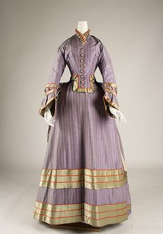 Not an 1850s dress, but an unexpected color scheme and graphic trim my protagonist, Clare Hetton, would like.