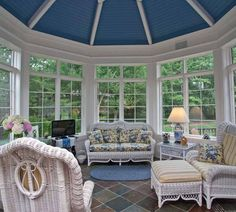 Sunroom. The blue ceiling is just fabulous