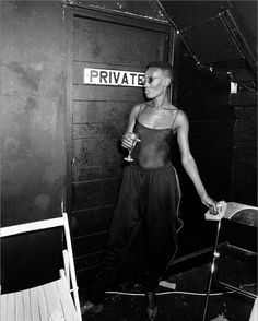 Grace Jones. Private with a see-through tank.