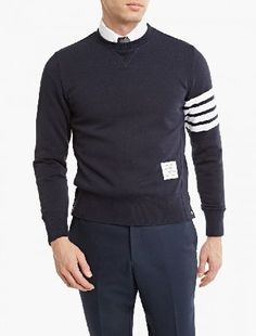 Thom Browne Navy Cotton Sweatshirt The Thom Browne Cotton Sweatshirt for SS16, seen here in navy. - - This sweatshirt from Thom Browne is crafted in Italy from wonderfully soft cotton and cut to offer a relaxed fit. SS16 sees the intro http://www.MightGet.com/january-2017-13/thom-browne-navy-cotton-sweatshirt.asp