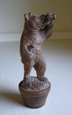 I love an old, well carved bear, particularly a Black Forest bear from Germany.