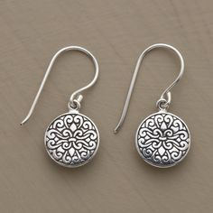 """SWIRL DE LYS EARRINGS -- A fleur-de-lys motif carved in a sea of swirls adorns the fronts and backs of our exclusive sterling silver earrings. The decorative disks hang from sterling French wires. Exclusive. Approx. 7/8""""L."""