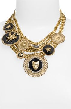 I am kind of obsessed with this necklace...I wonder if I could recreate it with vintage charms/medallions