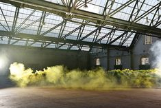 Colorful Smoke Emphasizing Industrial Buildings in Brussels  For the Art Brussels of this year the organization asked OTTOMURA to make a creative campaign in order to announce the event. The photography Belgian collective had the idea to capture colorful smoke pictures in empty industrial spaces that seem abandoned. It gives an ethereal and abstract result mixing yellow blue pink and green in factories corridors and alcoves.        #xemtvhay
