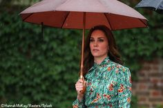 The Duchess was in a silk dress by Prada. I don't think anyone was surprised to see a floral print, a nod to the occasion in a color that wouldn't stand out or be a distraction. The poppies in the print were a lovely symbol, representing remembrance and consolation.