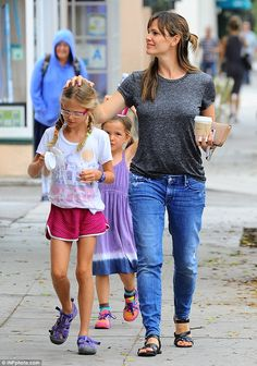 Treat yourself: Jennifer Garner patted her daughter Violet's head while Seraphina followed close behind with an ice cream cup upon her head in Santa Monica on Monday
