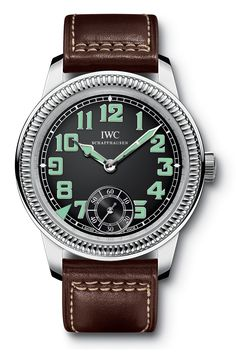 """IWC Vintage Pilot's Watch hand wound-  A modern interpretation of the """"mother of all IWC Pilot's Watches"""" featuring the classical instrument look of a cockpit with luminescent hands and numerals. Technically speaking, the Pilot's Watch Hand-Wound with its rotating bezel, pocket watch movement from the 98000-calibre family, large screw balance and Breguet spring represents the state of the art. With see-through sapphire-glass back."""