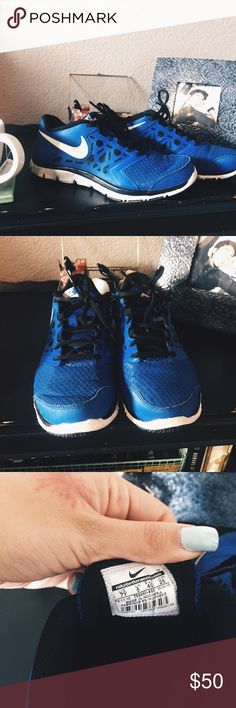 Blue and Black Nikes Only worn a few times! Still great condition!! 7 Youth // fits like Women's 8 Nike Shoes Sneakers