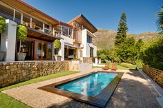 Orange Villa - This modern and spacious villa is located in the heart of Hout Bay and is the ideal destination for a longer escape in Cape Town. The villa has three bedrooms and sleeps a total of ten people.  Each of ... #weekendgetaways #houtbay #southafrica