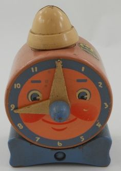 This neat, whimsical looking wooden toy clock is also a bank.