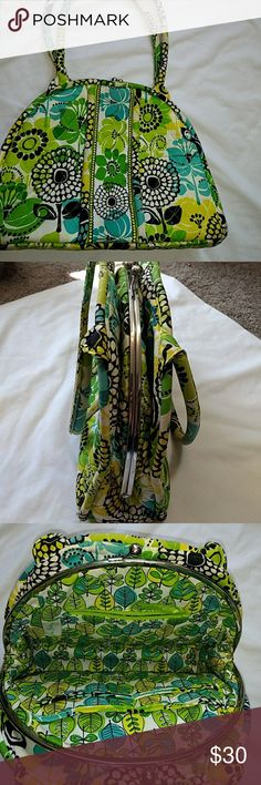 Vera Bradley Handbag Vera Bradley Purse green, yellow,black, teal color, silver metal opening with one zipper pocket and 4 open pockets inside, Side opening of purse has 2 open pockets, Other side opening also has 2 open pockets,  Handles need cleaning, 9x13, measurements are approximate and in photos, Vera Bradley Bags