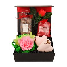 "This ""loving bath"" gift box hamper is filled with lovely romantic treats to enjoy some indulgent bath time. Included are Mega fizz bath hearts, bath confetti, rose candle, passion potion and delicious sweet chocolate delights. Perfect gift for the one you love."