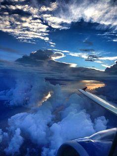 Beautiful sunrise shot from a plane window by Twitter user @CassArchut