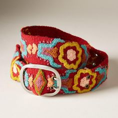 "NOUVEAU BLOSSOM BELT -- Brilliant zinnias bloom alongside delicate French knots in our artisan-made floral wool belt. Dry clean. Imported. Exclusive. Sizes S (32""), M (34""), L (36""). Approx. 2""W."