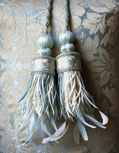 Lovely tassels with feathers. I have four yards of this damask material!!