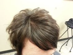 Short, textured haircut with side swoop bangs for fine hair.