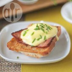 Treat yourself to a classic eggs Benedict for late breakfast or brunch. Poached eggs served on top of buttered toast with ham and homemade hollandaise sauce. You can change it up by using bacon, smoked salmon or spinach instead of ham.