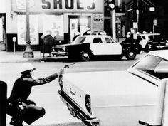 A Policeman Aims by Everett - 1965 Watts Riots. A Policeman Aims Photograph - 1965 Watts Riots. A Policeman Aims Fine Art Prints and Posters for Sale African American Culture, American History, Watts Riots, Los Angeles Police Department, Sale Poster, Police Cars, History Facts, Historical Photos, Poster Prints
