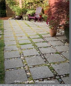 So nice. A Sustainable City Farm Garden (25/25), permeable patio with concrete aggregate pavers for water drainage in backyard garden	 Filename: holt_982_0171.jpg Copyright © Saxon Holt/PhotoBotanic.415-898-8880, http://photobotanic.photoshelter.com/gallery-image/A-Sustainable-City-Farm-Garden/G0000evH9qWadvkE/I0000mx5Fns7Ql3A