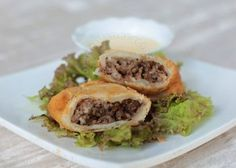 The flakiest empanada crust is made by following the recipe for samosa. Get the recipe and tips for making various fillings and how to use an empanada maker.