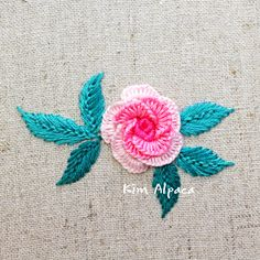 cast on stitch rose hand embroidery cast on rose stitch Hand Embroidery, Embroidery Designs, Casting On Stitches, It Cast, Throw Pillows, Rose, Needlepoint, Toss Pillows, Pink