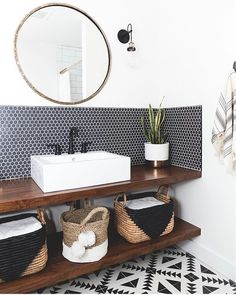Creative storage solutions for our custom floating vanity. I love the depth the wood brings to this B&W game. Bad Inspiration, Bathroom Inspiration, Bathroom Trends, Bathroom Renovations, Bathroom Ideas, Bathroom Colors, Small Bathroom, Open Bathroom Vanity, Boho Bathroom