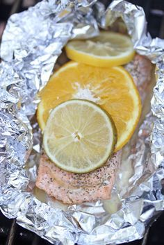 ... grilled salmon packets with tomatoes olives garlic thyme and saffron
