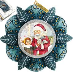 Features:  -Comes in a beautiful decorative gift box.  -Made in the USA.  Product Type: -Shaped ornament.  Theme: -Floral/Santa.  Color: -Multi.  Country of Manufacture: -United States.  Primary Mater