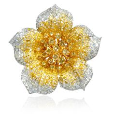 18k white and yellow gold flower brooch pin, contains 163 round brilliant cut white diamonds, of F color, and SI2 clarity, weighing 3.32 carats total with 519 round cut fancy yellow diamonds, weighing 6.18 carats total.