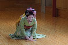 April 2015: maiko Hisamomo of Pontocho with custom cherry blossom kanzashi and high okobo shoes