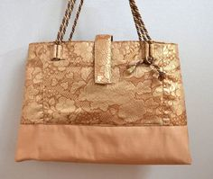 $255 Vintage Obi Tote Bag from Japan by Kimokame.  Gorgeous gold Obi fabric with various beautiful Japanese flowers inwoven.  Silk 100%  http://kimokame.com/shop/