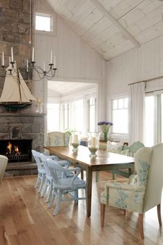 Designer Sarah Richardson, from HGTV's Sarah's House, used a wide-stripe fabric from Schumacher, aptly named Summerside, on the back of the armchairs in the lovely white dining room of her summer cottage. Richardson also piled on pillows in fanciful patterns, including a blue paisley.
