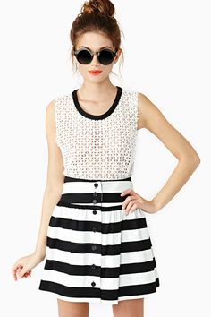 """Lydia Stripe Skirt: Way cool black and white stripe skirt featuring a high waist and pleated detailing. Button closures at back, unlined. Looks cute paired with a crop tank and circle shades!         *Cotton/Spandex Blend   *13"""" waist   *16.5"""" length   *Model is wearing size small   *Measurements taken from size small   *Hand wash cold  *Made in USA"""