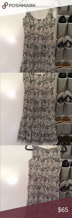Tahari Sleeveless Dress Gorgeous new condition to wear for work chic, sunny day or date night fun! Tahari Dresses