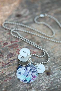 Custom Metal Charm Necklace with Hand Stamped Charms. $35.00, via Etsy.// My FAVORITE necklace EVER of my 4 babes from El Photography & Design!
