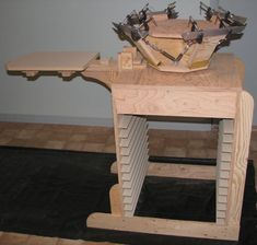 DIY 4-Color Screen Printing Press - I like that this one has built-in screen storage underneath :)