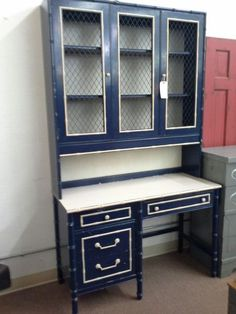 SOLD - This is a 4 drawer Thomasville desk with a removable , lighted Hutch top. The desk and Hutch have chippy and white paint. Measuring 46 inches across the front and 19 inches deep.  The desk stands 30 inches tall and the hutch top is an additional 50 inches tall.  This set can be seen in booth D 16 at Main Street Antique Mall 7260 East Main St ( E of Power Rd ) Mesa 85207  480 9241122open 7 days 10 till 530 Cash or charge 30 day layaway also available