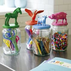 What a cute idea!  Great for kids room to eliminate clutter and organize pencils, crayons and small items.. paint jar lids, glue on animals!  Or choose things like thimbles and thread spools for the top and use these cute jars in your craft room!..Great way to recycle those cute spaghetti sauce jars!