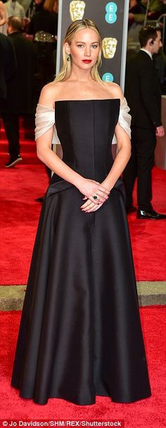 Jennifer Lawrence made a showstopping entrance at the BAFTAs at London's Royal Albert Hall on Sunday, where she will serve as one of the presenters for the star-studded evening.